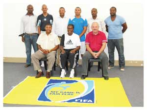 The new coaching instructors with mentors Klaus Staerk (seated right) and William Kapukare (seated left)