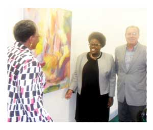 Minister of Foreign Affairs, Hon. Netumblo Nandi-Ndaitwah appreciates the first art work donated by Namibia to the new African Union conference centre in Addis Ababa. Assisting her are the Deputy Minister of Youth, National Service, Sport and Culture, Hon. Juliet Kavetuna and the Director of the National Art Gallery, Professor Hercules Viljoen.