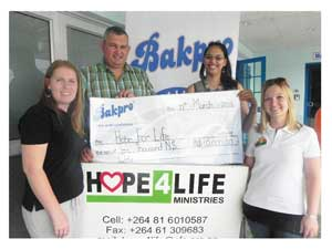 Anne Mans, Ian Collard, Namib Mills MD, Charlene Uakuramenua and Christine Venter celebrating RadioWave's windfall for Hope for Life.