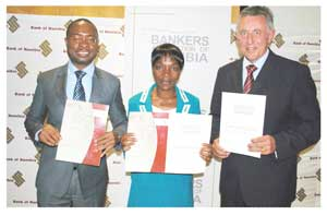 Ipumbu Shiimi Governor of the Bank of Namibia, Ericah Shafudah, Permanent Secretary of the Ministry of Finance and Christo de Vries, Chairman of the Bankers Association of Namibia (BAN) at the launch of the Code of Banking Practice in Namibia and Guidelines for Lodging Customer Complaints.