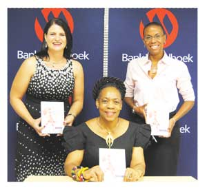 Marlize Horn of Bank Windhoek with Anne Thandeka Gebhardt, President of House of Women and Afra Schimming-Chase of Chase & Associates, at a preparatory meeting to discuss the workshop stationary.