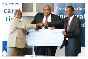 Shihaleni Ndjaba, (centre) CEO of the Diamond Trading Company officiated at the landmark event where N$110 million in dividends were paid to its shareholder, the government of Namibia. Minister of Mines and Energy, Hon. Isak Katali (left) received the cheques on behalf of the government. Making sure the funds are properly presented is Festus Mbandeka Chairperson of the NDTC Board of Directors.