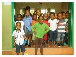 These happy juveniles at a Windhoek crèche are some of the fortunate children who benefit from basic services such as education, clothing and shelter (Photograph by Hilma Hashange).