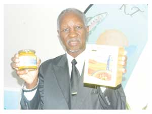 Ambassador Nicky Nashandi, a member of the Board of Directors at Kuiseb Trading with some of the fish products (Photograph by Lorato Khobetsi)