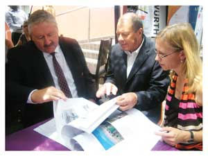Head of Corporate Communication and Social Investment at Bank Windhoek, Riaan Van Rooyen, Director of the National Art Gallery, Hercules Viljoen and GIZ- Support to Land Reform representative, Martina Romer going through the Land in Art catalogue at a media briefing earlier this week. (Photograph by Melba Chipepo).