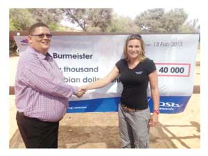 MultiChoide General Manager Roger Gertze with the first winner of the ongoing Dstv subscription rewards competition, Vester Burmeister.