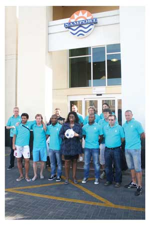 In front of the Namport Head Office is the Manager: Corporate Communication, Liz Sibindi with some of the players.