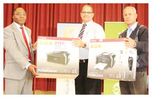 From left to right, Mr Sakaria Nghikembua, Old Mutual CEO of Operations, Mr. Ernest Olivier,  Principal at Namib High School and Mr. Mark Jacobs of the Erongo Education directorate.