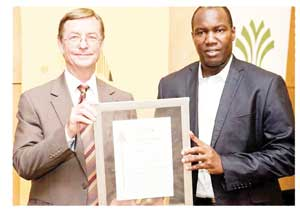 Valued in billions. Tilman Friedrich (left) and Marthinuz Fabianus (right) of Retirement Fund Solutions receive the PMR Gold Award. The company recently announced that it administers N$11 billion in pension funds.
