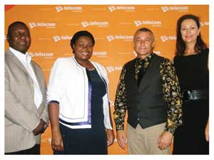 Telecom's Senior Manager of Corporate Communications and Public Relations, Oiva Angula,  Businesswoman of the Year 2010 and also Managing Partner and Director of PricewaterhouseCoopers, Nangula Uaandja, guest speaker Edward Ward and Chairperson of the Economist Businesswomen Projects, Desere Lundon-Muller at the networking breakfast held last week Friday. (Photograph by Melba Chipepo).