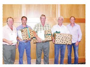 Overall winners: Tobie Barlow, operations manager receives the Aranos branch's certificate on behalf of branch manager, Leon van Rensburg, Karibib branch manager and Bonnie van Zyl of Outjo; Peter Kazmaier with Aranos's gift and general manager: retail, Arnold Klein.