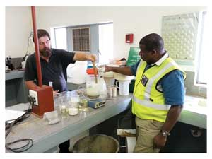 Mr Eben Visser, Namibian Agronomic Board research and development consultant with the Minister of Agriculture, Water and Forestry, Hon. John Mutorwa, in the laboratory where phosphate is extracted on an experimental basis from the tailings of Okuruso Fluorspar mine.
