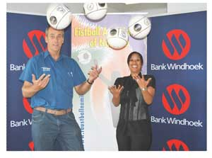 Michael Baas, President of the Fistball Association of Namibia (FAN) and Elzita Beukes, Communication Practitioner: Stakeholder Engagement at Bank Windhoek at the handover ceremony.