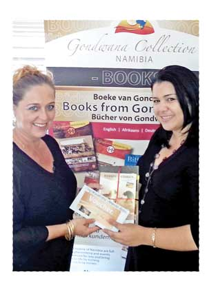 Gondwana Card consultant Anthea Cloete (right) hands the voucher booklet for 25 nights to the winner, Amanda Aston. (Photograph by Gondwana Collection Namibia)