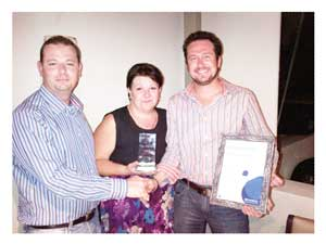 Fred van Biljon (left), New Business Development Manager at Sage VIP Payroll & HR South Africa  with Jolanda Opperman, Branch Manager at Sage VIP Payroll & HR Windhoek presenting the award to Michael Nieuwoudt, Managing Member and Owner of ACCSYS cc.