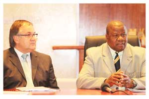 Kobus van Graan, Chairman of the the Namibian Agronomic Board and Minister of Agriculture, Water and Forestry, Hon. John Mutorwa at the signing ceremony (Photograph by Thoko Mdlalose)