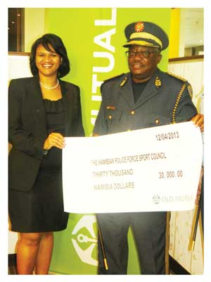 Old Mutual Retail Mass Market Executive Manager, Martha Murorua handing over the N$ 30 000 cheque to Inspector General of the Namibian Police Force, Lieutenant General Sebastian (Photograph by Lorato Khobetsi)