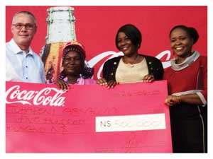 Pottie de Bruyn, Coca Cola's Country Sales and Marketing Manager, Winner of N$500,000 Meme Tuhafeni Absalom and her sister Elizabeth Akubia together with Suprian Kamotho, Coca Cola's Senior Operations Marketing Manager for Botswana, Lesotho, Namibia and Swaziland during the handover of the prize cheque. (Photograph by Hilma Hashange)