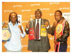 Managing Director of Telecom Namibia with boxers Joseph 'Smokey' Hilongwa and Albinus 'Danny Boy' Felicianu.(Photograph by Melba Chipepo)