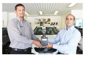 Volvo Brand Manager, Johan Lucas (left) with Novel Motor Company MD Ricardo Raposo, and the Most Improved Dealer award won by Volvo Cars Windhoek at the recent Volvo SA awards ceremony.