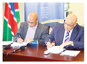 Namibia Statistics Agency Statistician General, Dr. John Steytler and Admir Bay, Resident Representative of Food and Agriculture Organisation (FAO) during the official signing agreement of the Namibia Agriculture Census.