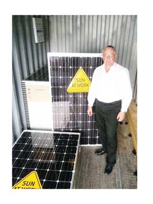 O&L Energy Managing Director, Bernd Walbaum with to the solar power system that will be installed on the roofs of the buildings of the Duetsche Schule Pretoria.