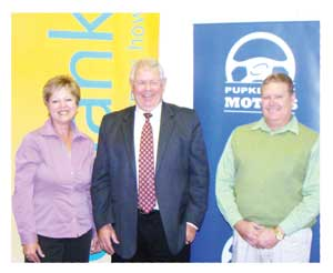 WesBank's Elmarie Cilliers with Junior Bruwer, Managing Director of Pupkewitz Motor Holdings (centre) and Harried Reed, also of WesBank (right.)