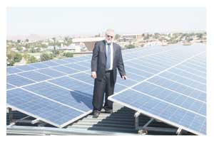 Minister Calle Schlettwein at the inauguration of the NDC photovoltaic system. (Photograph by Tabby Moyo)