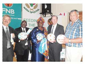Dixon Norval, Head of Strategic Marketing and Communications at FNB Namibia, Reverend Ludwig Hausiku, Special Advisor to the Ministry of Youth, National Service, Sport and Culture, Dr Becky-Ndjoze Ojo, Principal of St. Paul's College,Ian Leyenaar CEO of FNB Namibia. And Ian Collard, MD of Namib Mills. (Photograph by Lorato Khobetsi)