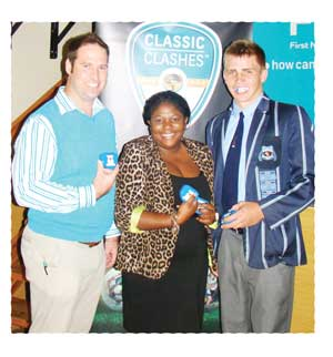 Say cheese....Dr. Pieter Coetzee From MAX Mouthguards, Vicky Muranda of FNB Namibia and HJ du Plessis, captain of the WHS rugby team at the launch of the FNB Classic Clashes.