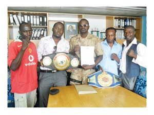 "from left to right: Sakaria Lukas (Boxer), Martin K. Mbambus (Information and Marketing: Warriors Promotions), Ludwig Haimbodi: Chairman: Warriors Promotions, Joseph ""Smokey"" Hilongwa: WBF Inter Continental Super Flyweight Champion and Tommy ""Show"" Nakashimba: Namibian National Featherweight Champion."