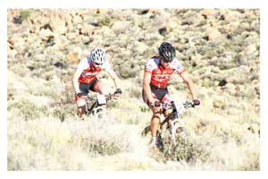 Martin Freyer of Team Kia leading eventual winner Tristan de Lange.