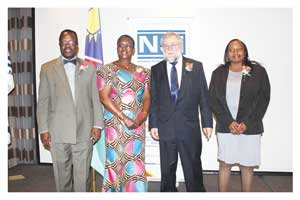 From left: Mr. Riundja Kaakunga, CEO of the Namibian Standards Institution, Mrs. Maureen  Mutasa CEO of the Southern Africa Development Community Accreditation Service (SADCAS), Hon. Calle Schlettwein, Minister of Trade and Industry, and Dr. Martha Kandawa-Schulz, Chairperson of the Namibian Standards Council, the NSI's governing board.