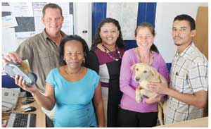 "FNB Namibia recently installed an FNB Speedpoint at the SPCA compound in Windhoek. It is the first time in its history that the SPCA can process electronic payments at its premises. The bank has made this service available at a special rate by waiving installation fees as well as the monthly rental. Rene Botes (Manager FNB Windhoek Speed point Department) officially handed the system over to the SPCA last week, to facilitate them with fast, reliable and safe money transactions at the animal shelter. In addition, Internet Technologies Namibia (ITn) sponsored the electronic installation and G-Pad connectivity. Botes said that they are making available a mobile Speed Point device, which can be used for future FNB fund raising projects. The Speed Point takes all Visa and Master Cards. ""The SPCA is most grateful to the FNB for their valuable contribution, and are looking forward to a longstanding relationship with the bank, for the benefit of the animals."" said Sylvia Breitenstein (Chairperson Windhoek SPCA), Here, Rene Botes talks to SPCA receptionist Stella Kheimses, joined by Vinessa Davids (FNB), Hilary Du Plessis (SPCA Manager) and Reggy Louw (FNB)."