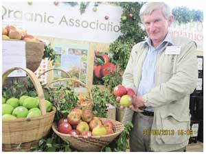 Mike Prevost offering some of his organic grown apples. (Photograph by Hilma Hashange)