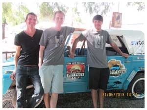 Tim Wucher, Daniel Theil and Oliver Pieters pose next to their Kuebelwagen. (Photograph by Hilma Hashange)