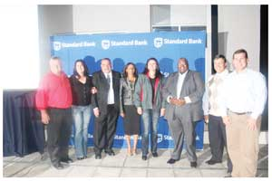 Standard Bank Namibia 2013 Auto Show launched. Posing with participating car dealers, is the bank's Chief Executive Mpumzi Pupuma (3rd from left), Head of Personal Banking, Baronice Hans (5th from left), next to her Head of Vehicle Asset Finance, Wim Lötter and (far right) VAF's New Business Manager, Eugene Junius.