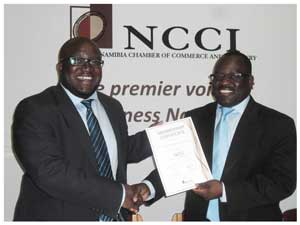 Namibian Marine Phosphate (NMP) this week received its certificate as the newest National Corporate member of the Namibian Chamber of Commerce and Industry's (NCCI). Barnabas Uugwanga, CEO of NMP accepted the certificate from Tarah Shaanika, CEO of the NCCI on Monday. (Photograph by Lorato Khobetsi)