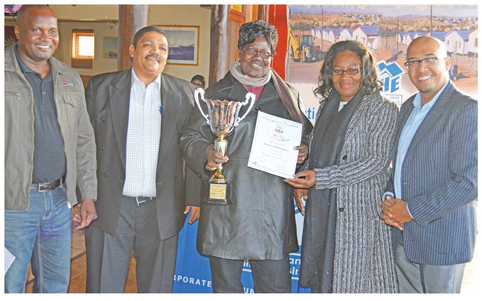 From left to right: Shali Akwaanyenga, PRO of the Lüderitz Town Council, Willem Titus, Acting Manager: Business Development & Operations at National Housing Enterprise (NHE), Selma Shilongo, Shilongo Leather Works, (Overall Winner: Lüderitz Crayfish Festival), Cllr. Suzan Ndjaleka, Mayor of Lüderitz, Gladwin Groenewaldt, Senior Corporate Communication Officer, NHE.