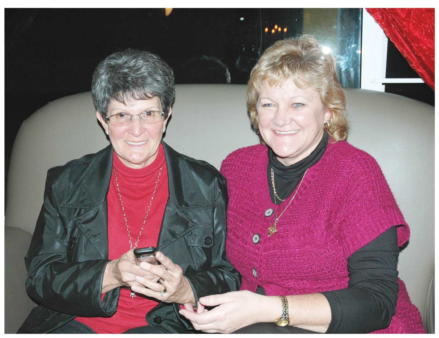 Martha Liebenberg (left), a senior citizen and a client of Bank Windhoek in Henties Bay, uses Bank Windhoek cellphone banking to do her banking transactions whenever and wherever she wants. She is with Elmarie Riekert, Branch Manager of Bank Windhoek in Henties Bay.