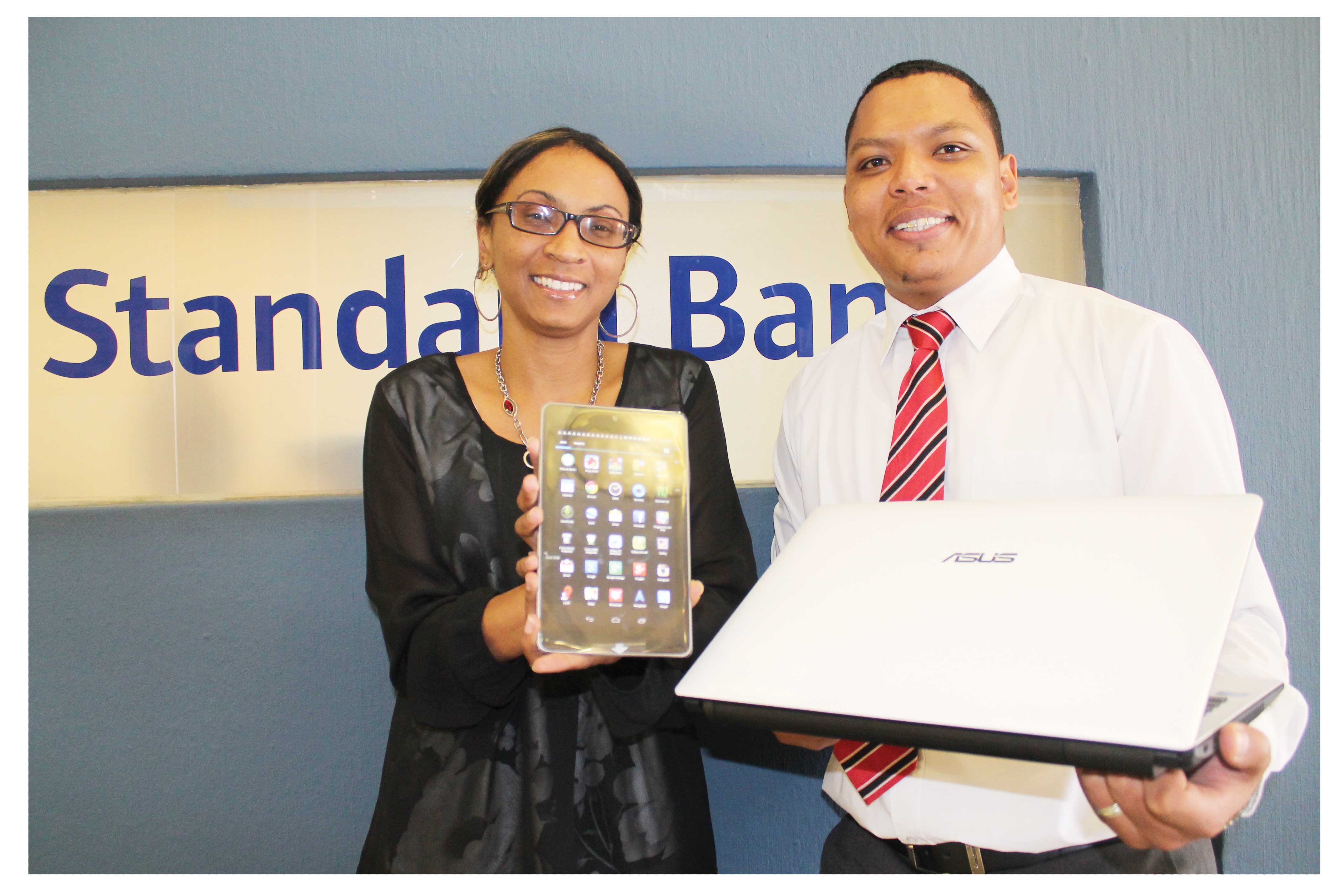 Offering the latest in smart device deals, Standard Bank's Head of Personal and Business Banking, Baronice Hans and Manager of Internet Banking, Rivan Meyer show the Asus laptop and Google Nexus Tablet.