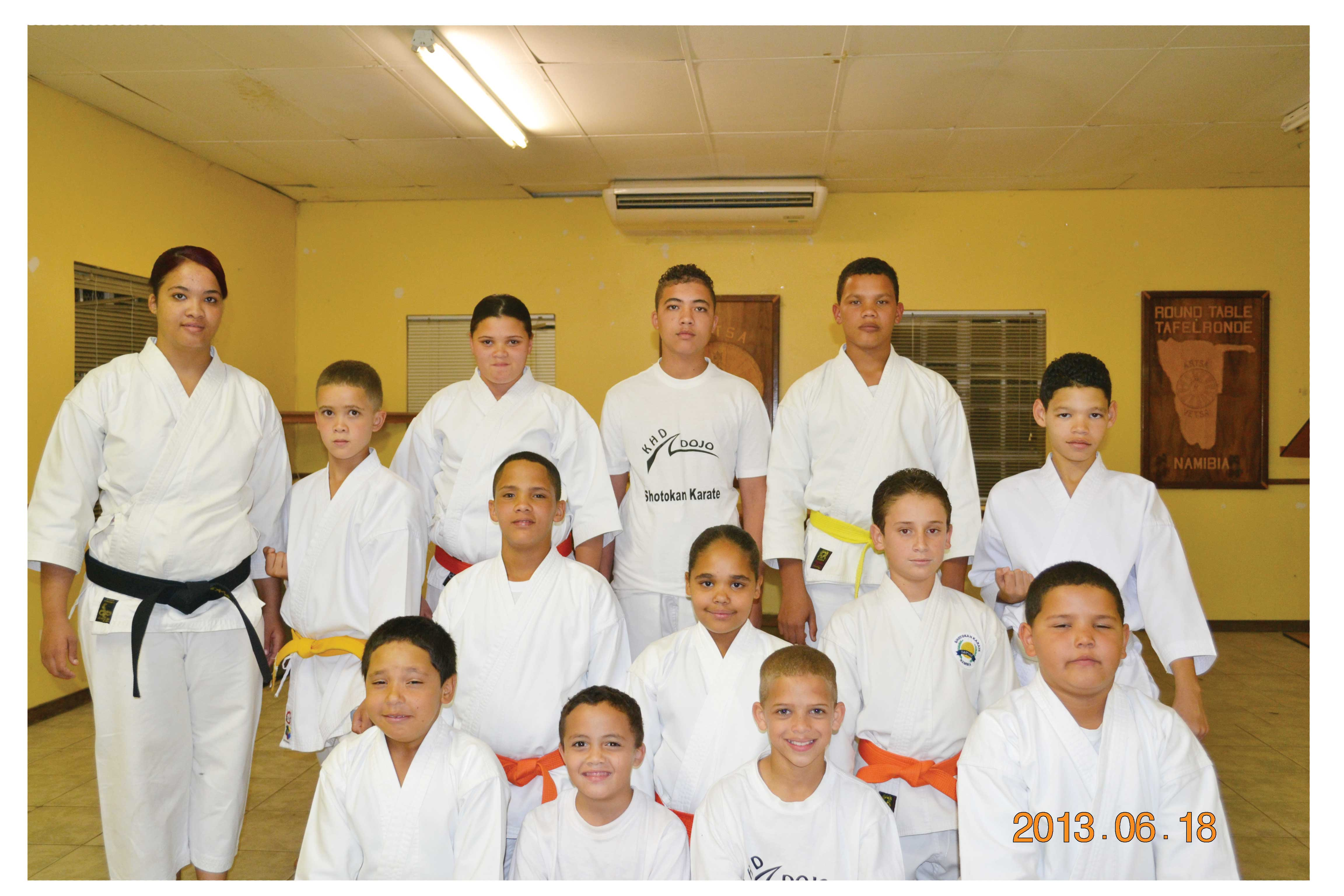 Sensei of the Khomasdal Shotokan Dojo, Morchen Kruger (on the left) with her assorted team of karateka that will travel to South Africa in August to participate in the Shotokan International Development Tournament