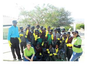"Operation ""Clean-Up"" with the learners of the Dr Frans Aupa Indongo Primary School in Katutura. On the right is Mona-Liza Garises, Vivo Energy's Communications Manager."