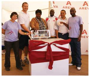 Mrs Kavita (centre) of the House of Safety receiving a fridge and a cash grant from Areva represented by Sugnet Smit (Communications Specialist, left), Tommie Gouws (Financial Manager), and the Sport Committee, Gerson Geingob, Jacques van Wyk and John Nekongo.