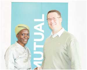 Hilmar von Lieres, an Old Mutual Personal Financial Adviser working at the coast with Lucia Hamukoto, a mother who wants to open her own kindergarten. She won a SmartMax Education Policy from the life insurer.
