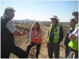 Johan Kornelissen, Occupational Hygienist at National Environmental Health Consultants discussing strategy with the contractors to improve dust control at the Hilltop Estate Development.