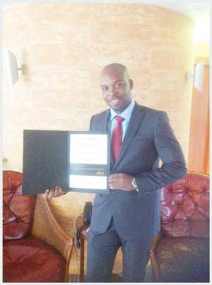 Chief Executive Officer of the Environmental Investment Fund of Namibia, Benedict Libanda with the award the fund received in Germany.