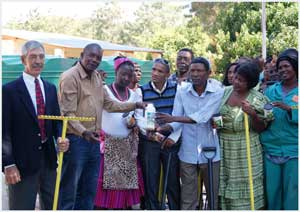 Tsumeb Deputy Mayor Anthonie van der Smit (left) with Mayor Lineekela Sheetekela and the SOS Family support group at the ceremony where the Ministry of Health and Social Services donated the required tools and seeds to enable Tsumeb's SOS Family Support Centre to grow its own vegetables. (Photograph by Josephina Shilongo)