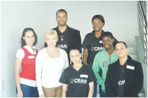 Welda Mouton from the United Nations Information Centre, Anthea Basson National Information Officer and Stanley Shanapinda, CEO of CRAN together with learners who took part in the MUNNAM Conference. (Photograph contributed)