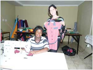 Jennieke Boiler, project manager at Anusa Schoolwear with Paulina Gotlieb, an employee at the Anusa Schoolwear project. (Photograph by Lorato Khobetsi)